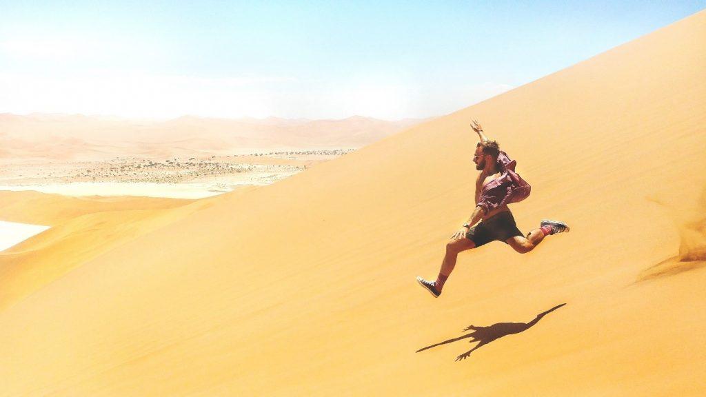 man-jump-sand-landscape