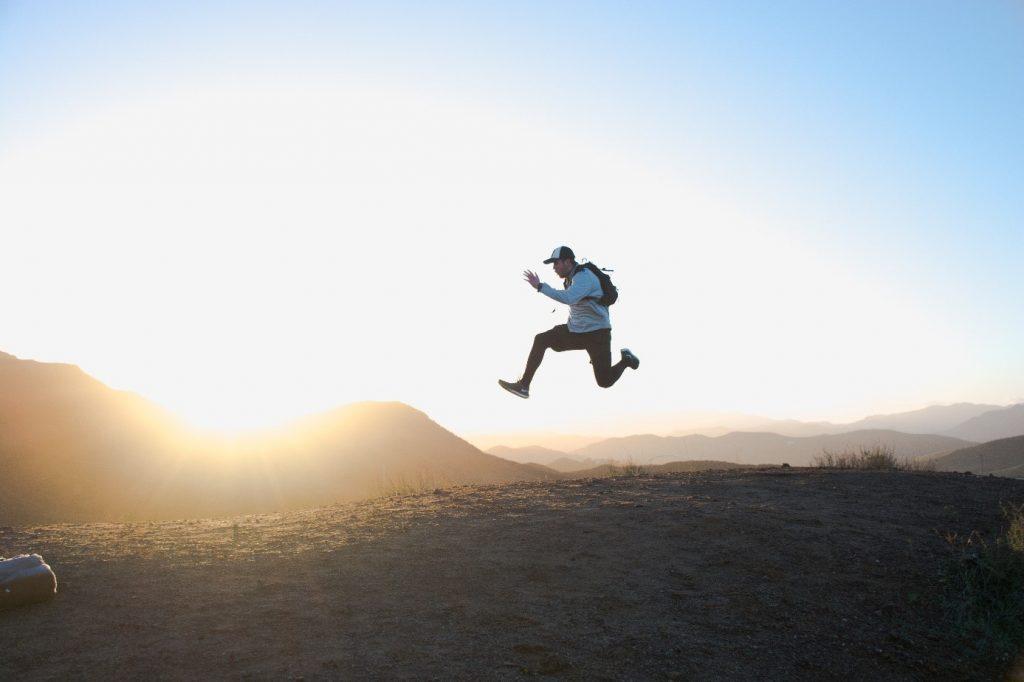 man-jump-wild-landscape