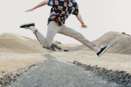 man-jumping-road